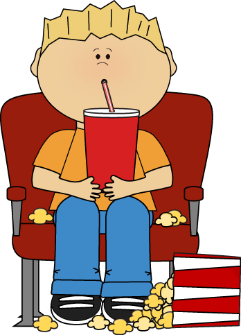 Boy in Movie Theater with Drink and Popcorn