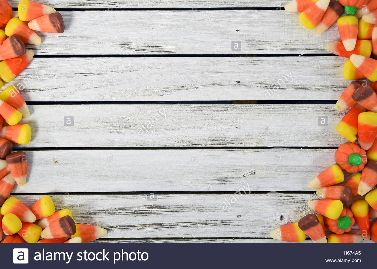 autumn candy corn border on gray rustic wood