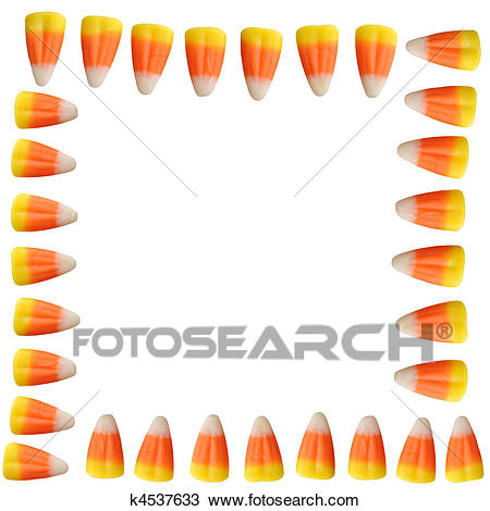 Halloween candy corn arranged in a border isolated on white background