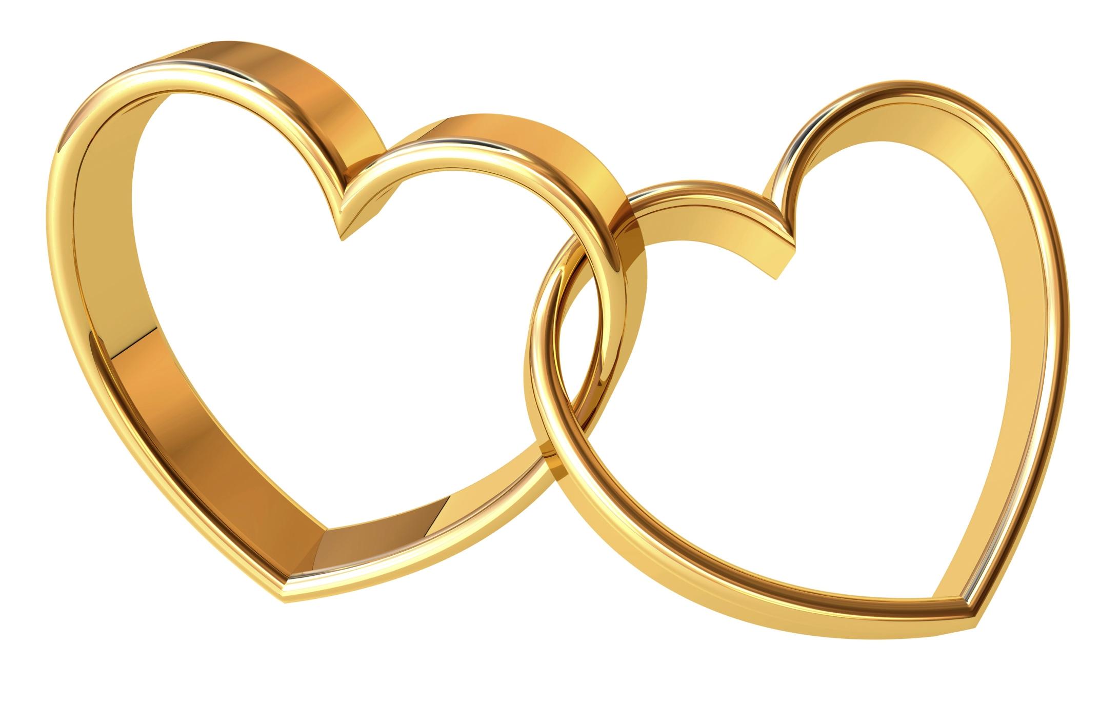 Cross and wedding rings .