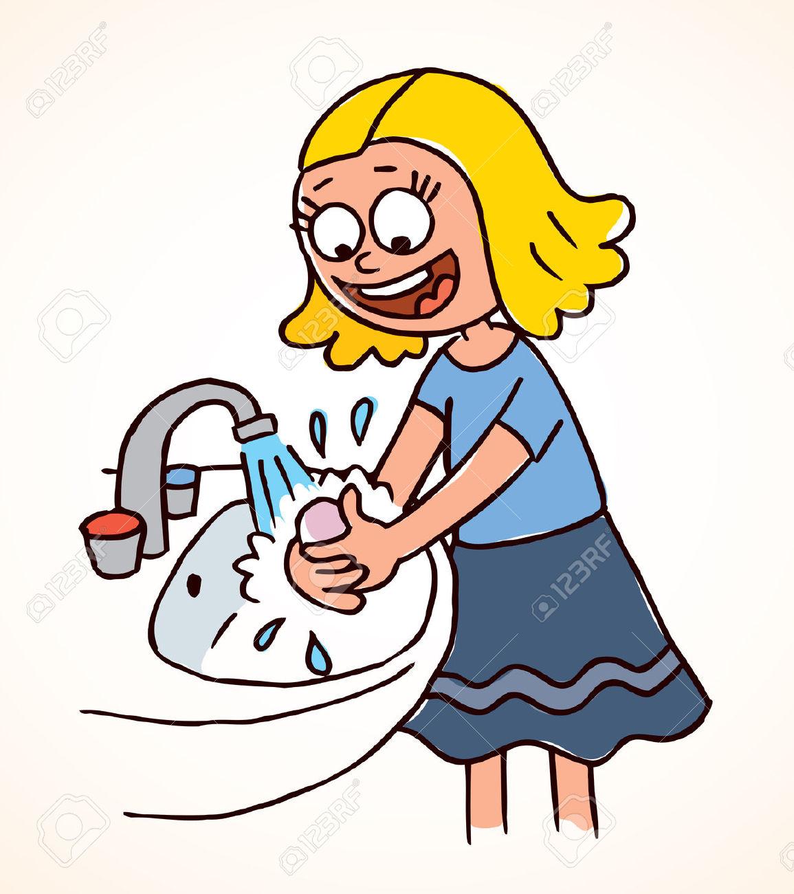 little girl washing hands .